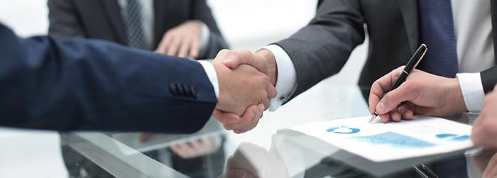 握手(IT業界のM&A締結)